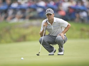 NORTON, MA - SEPTEMBER 2: Jordan Spieth lines up his eagle putt on the 18th hole, during the final round of the 2013 Deutsche Bank Championship at TPC Boston, Monday, Sept. 2, 2013. Spieth started the day tied for 29th place and ended his round tied for second place. (Photo by Matthew J. Lee/The Boston Globe via Getty Images)